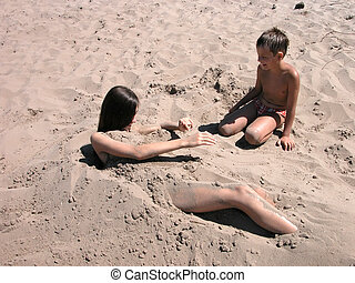 Boy and girl playing in sand