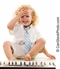 Little piano player - Adorable little three year old boy...