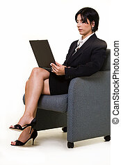 Waiting room work - Attractive brunette business woman...