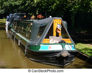 Canal boat - Canalboat moored alongside towpath on the...