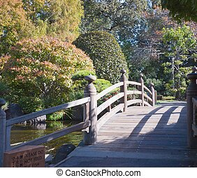 Small bridge over a pond in japaneese garden
