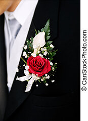 Groom\\\'s boutioniere on  tuxedo jacket