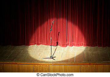 mic on stage - microphone on wooden stage, red curtain in...