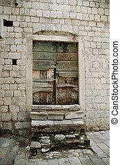 ruinous door - old ruinous door in the white bricks wall