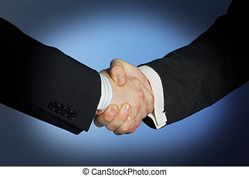 Shaking hands - business handshake over blue background