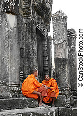 two young monks on temple background