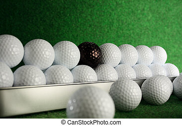 Golfballs with a bad friend amongst them