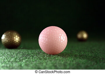 Pink golfballs with golden friends waiting for continous...