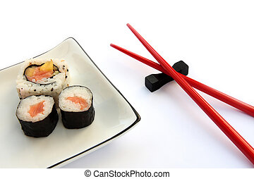 Sushi Plate - Sushi on a plate with chopsticks isolated on a...