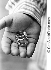 Wedding rings - Wedding bands in groomsmans hand