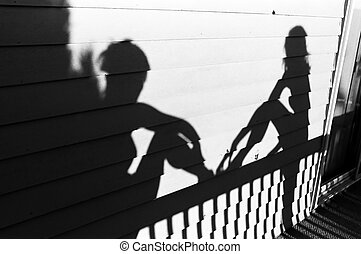 Shadow of bridesmaids on wall of reception site