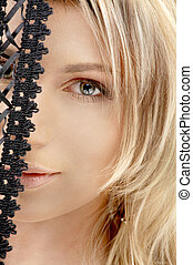 black lace - mysterious blond lookung through black lace...