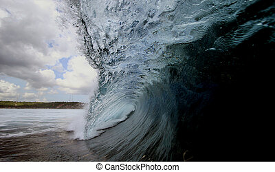 Perfect Wave - A perfect waves breaks over a shallow reef in...