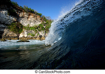 Cliff Hanger Wave - A perfect waves breaks in a shallow reef...
