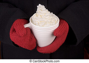 Mug of Hot Chocolate - women in a black coat with red...