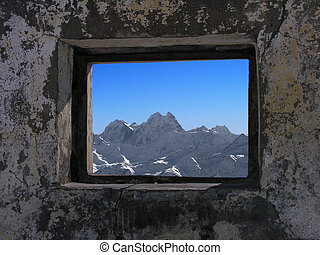 Kind on mountains from a window