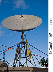 satelite - broadbrand satelite dish on  blue sky background