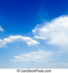 The blue sky is covered by white fluffy clouds.