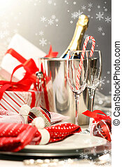 Christmas champagne with gifts against dark silver...