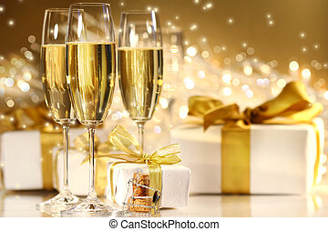Glasses of champagne with gold ribboned gifts