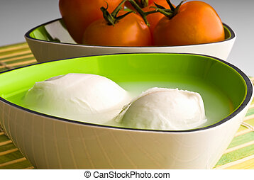 mozzarella cheese and tomatoes in the background