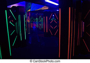 Laser Tag Anyone? - The colorful florescent lights of a...