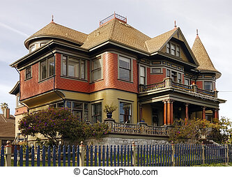 Victorian gingerbread house - A large Victorian home with a...
