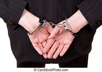 Corporate justice - Business person in suit in handcuffs