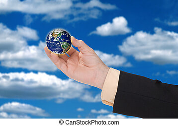 Businessman hand holding a globe