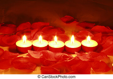romantic lights - Valentines day candles and rose petals.