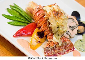 Lobster Dinner - Delicious meal of lobster and stuffed...