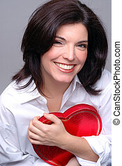 My Heart - Beautiful Brunette Young Woman Holding Heart...