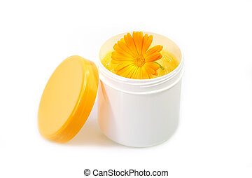 Handcream with marigold - Cream pot with marigold on white...
