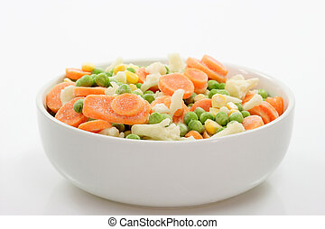 Frozen Food - Frozen vegetables in a bowl on light...