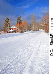 Snow covered road. - A snow covered road in the country.