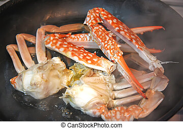 Cooking crabs - King crab parts being cooked in frying pan