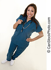 Happy nurse pointing - Full body of an attractive young...