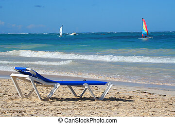 tropical Caribbean beach - empty beach chair overlooking the...