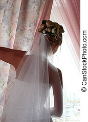 Silhouette of the bride - The beautiful bride prepares for...