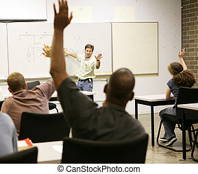 Adult Ed - Questions - Adult education class raising hands...