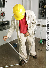 Electrician Bends Pipe - Electrician bending conduit pipe....