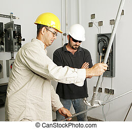 Electrical Team Bending Pipe - Electrician and foreman...