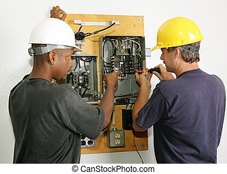 Electricians Repair Panel - Electricians repairing breaker...