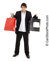 shopping man - handsome man with shopping bags over white