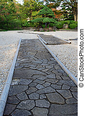 zen stone garden - stone way and evergreen tree in japanese...