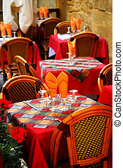 Restaurant patio - Set tables with tablecloth and glasses on...