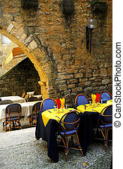 Medieval Sarlat, France - Restaurant patio among medieval...