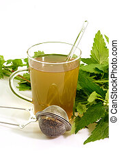 Glass of herbal tea - Herbal tea with fresh stinging nettle