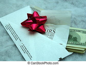 IRS present II - stack of money sticking out of an IRS...