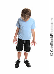 Boy looking down - Boy standing in plain blue t-shirt and...